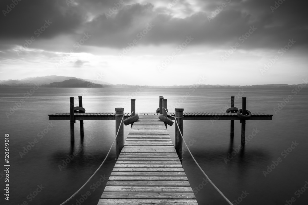 Wooden pier on the lake Zug, Switzerland. Long exposure. Black and White.