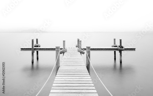 Fototapety, obrazy: Wooden pier on the lake. Fog. Long exposure. Black and White.