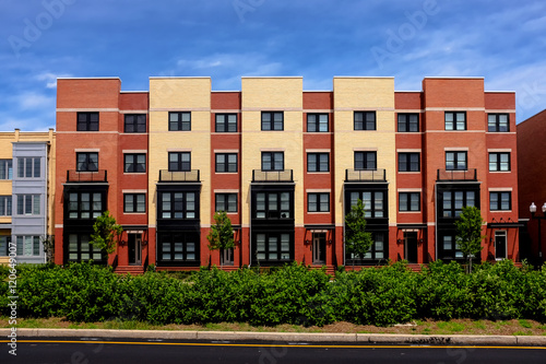 Modern apartment buildings on a sunny day with a blue sky Wallpaper Mural