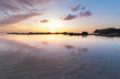 Beautiful sunset seascape color with reflection. image contain soft focus and blur due to long expose.