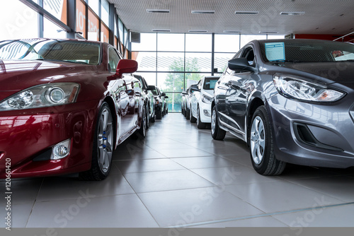 New cars at dealer showroom - Buy this stock photo and explore ...