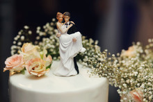 Funny Figurines Suite At A Luxury Wedding White Cake
