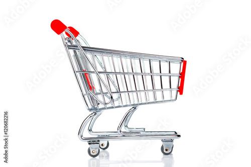 Fotografering  Shopping cart closeup on white background