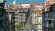 View of the Almeida Garret Square with the Sao Bento railway station and Congregados Church timelapse.