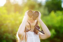 Funny Little Girl Looking Through Binoculars