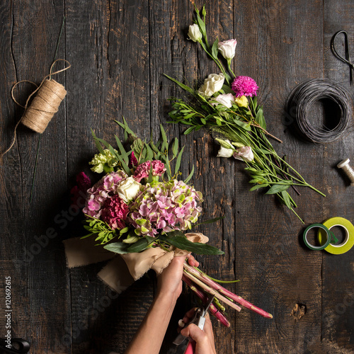 The florist desktop with working tools and ribbons