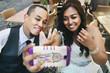 .Happy stylish smiling asian couple
