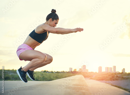 Healthy fit young woman doing crossfit exercises