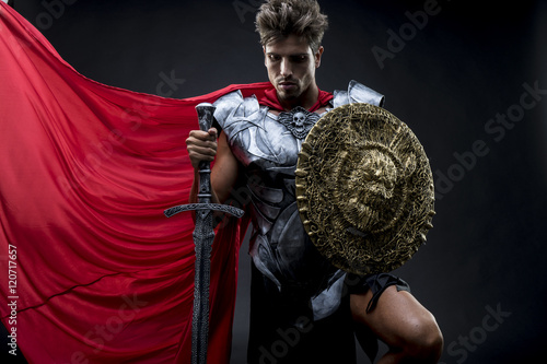 Fotografie, Obraz Conqueror, centurion or Roman warrior with iron armor, military