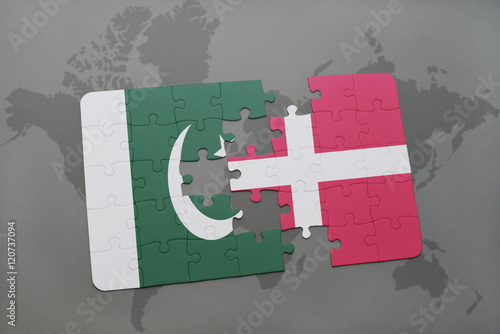 puzzle with the national flag of pakistan and denmark on a world map background Poster
