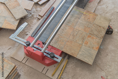 Industrial Tiler Builder Worker Working With Floor Tile Cutting