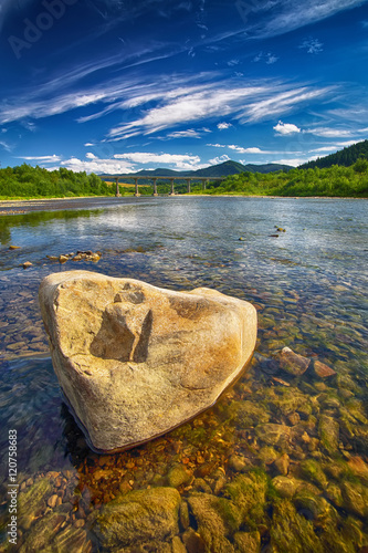 Keuken foto achterwand Noord Europa Mountain river stream of water in the rocks with blue sky