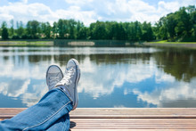 Feet Relaxing By A Lake On A Beautiful Summer Day. Location Czech Republic.