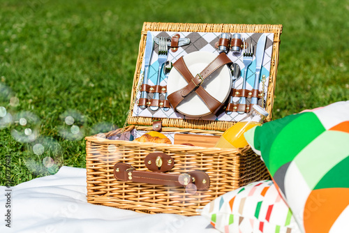Keuken foto achterwand Picknick Picnic Basket Food On White Blanket With Pillows And Soap Bubbles
