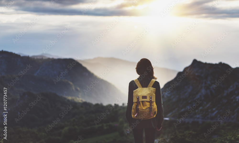 Fototapety, obrazy: Hipster young girl with bright backpack enjoying sunset on peak of foggy mountain. Tourist traveler on background valley landscape view mockup. Hiker looking sunlight flare in trip in northern spain