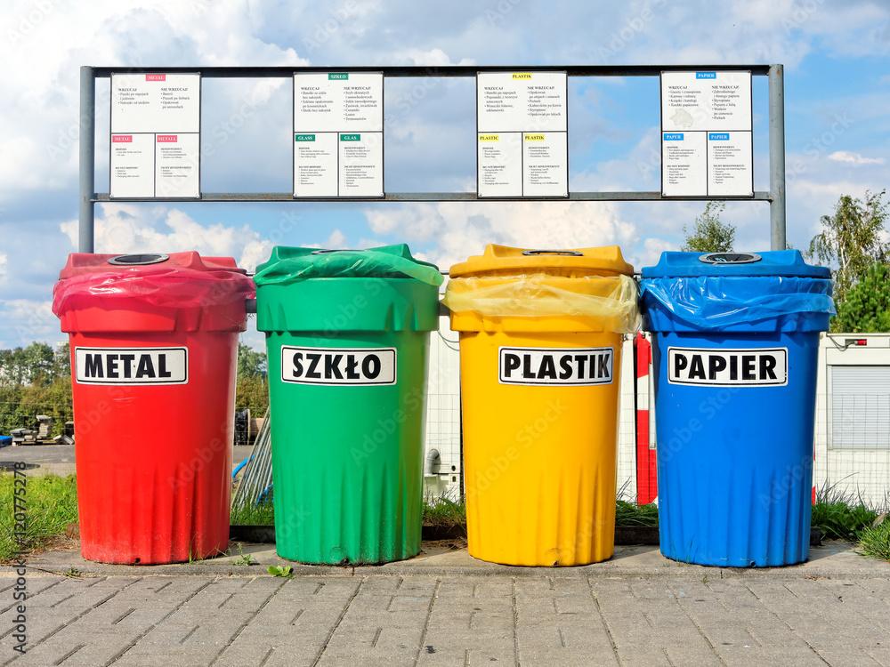 Fototapeta Color coded trash bins for waste segregation described in languages: Polish, English and German