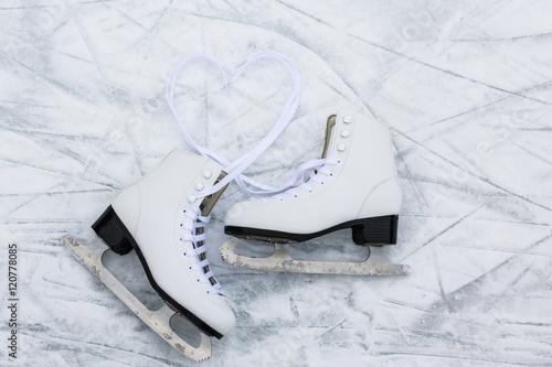 Fotobehang Wintersporten I love ice skating. Ice skates on rink background.