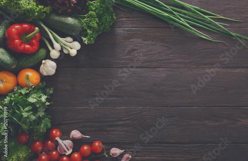 Fototapeta Border of fresh vegetables on wooden background with copy space obraz na płótnie