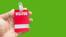 Holding Visitor Card
