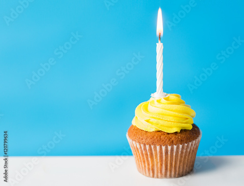 birthday cupcake with one burning candle Canvas Print