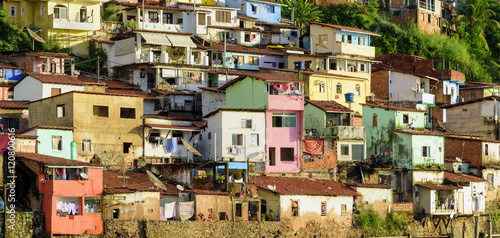 Fotografija  Contour shantytown with its colorful houses on the hill by the sea in the city o