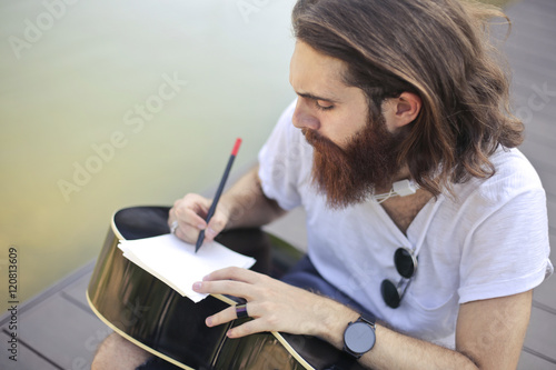 Guitarist composing new music Wallpaper Mural