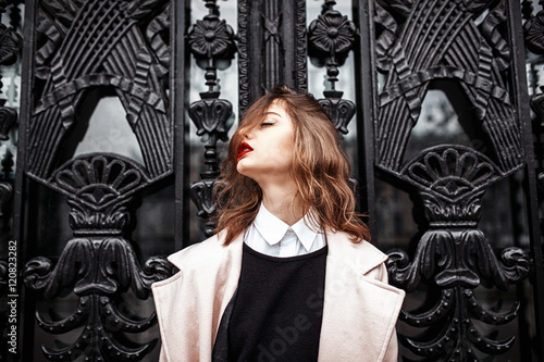 Plakat  Vintage Street fashion photo. Beautiful young woman in oversize