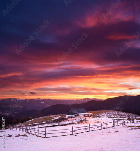 Foto op Plexiglas Crimson Beautiful sunrise in mountain village
