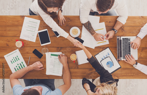 Fotografie, Obraz  Business people group handshake in office, top view