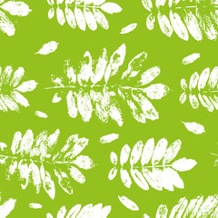 Fototapeta Seamless pattern with paint prints of leaves