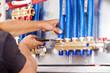 Leinwanddruck Bild - Plumber mounted distributor of central heating