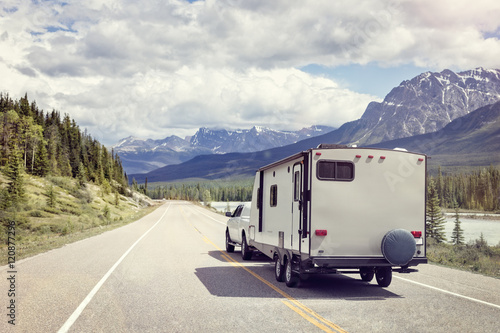 Caravan or motor home trailer on a mountain road Canvas Print