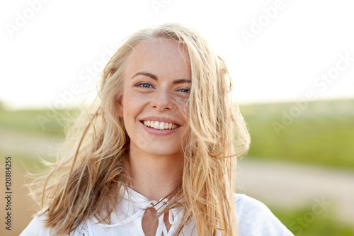 Fototapeta  close up of happy young woman in white outdoors