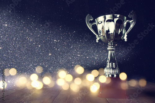 low key image of trophy over wooden table Wallpaper Mural