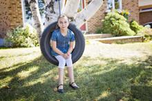 Portrait Of Girl On Tire Swing