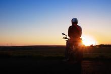 Junger Motorradfahrer Im Sonnenuntergang / Young Biker While Sunset