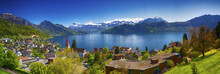 Panorama Image Of Village Weggis, Lake Lucerne (Vierwaldstatersee), Pilatus Mountain And Swiss Alps In The Background Near Famous Lucerne (Luzern) City, Switzerland