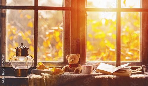Fotografie, Tablou fall. cozy window with autumn leaves, book, mug of tea