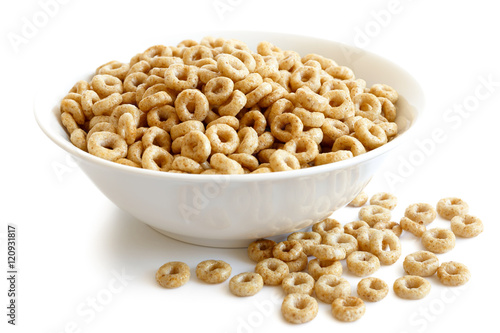 Bowl of honey cheerios isolated on white. Spilled cheerios. Billede på lærred