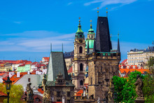 Mala Strana (Lesser Quarter Of Prague), Lesser Tower Of Charles Bridge And Church Of St. Nicholas. Prague, Czech Republic