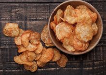Bowl With Potato Crisps Chips On Wooden Board