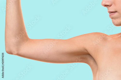 Fotografia, Obraz  Young blond woman showing flabby arm