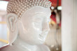 Beautiful white stone Buddha statue head. Buddhism sculpture calm, peaceful face