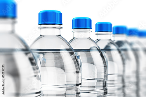 Fotografia, Obraz  Row of plastic drink water bottles
