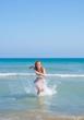 Woman in bikini enjoying the sea