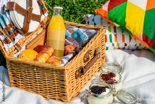 Keuken foto achterwand Picknick Picnic Basket With Fruits, Orange Juice, Croissants And No Bake Blueberry And Strawberry Jam Cheesecake