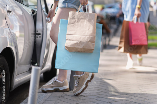 girl sitting in a car with her purchases