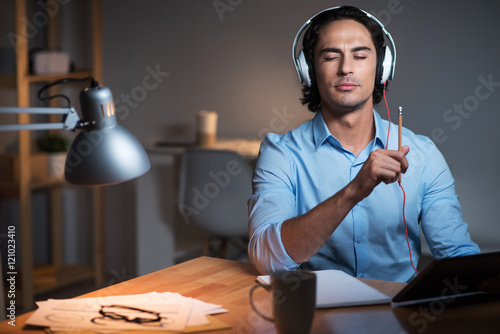 Fotografie, Obraz  Concentrated handsome man using laptop