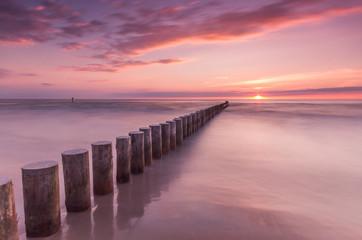 Panel Szklany Podświetlane Do pokoju Wooden breakwater - Baltic seascape at sunset, Poland