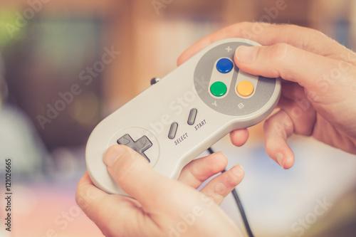 Photo  Game Controller retro in Männerhand